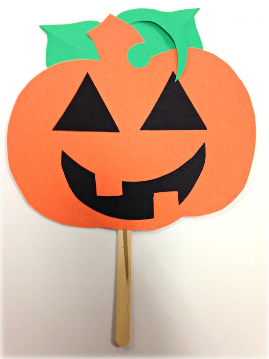 pumpkin head on stick